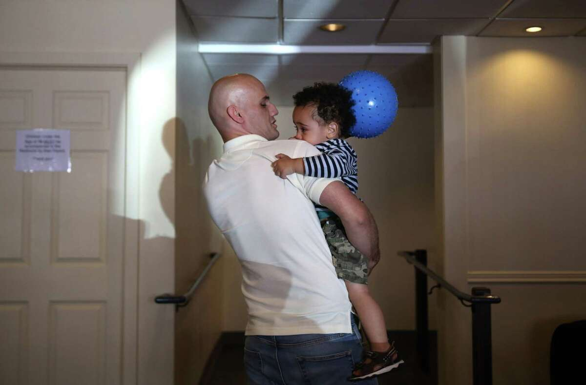 Ebrahim Jafari plays with his son Alraman, 2, in the Mary's Place day center, June 26, 2017. Jafari, who is a refugee from Iran, has 15 years experience as an HVAC specialist, but can't get a job in that industry here without going back to school to get licensed. He and his wife, Medina, and their two sons live at the Mary's Place shelter while he looks for work.