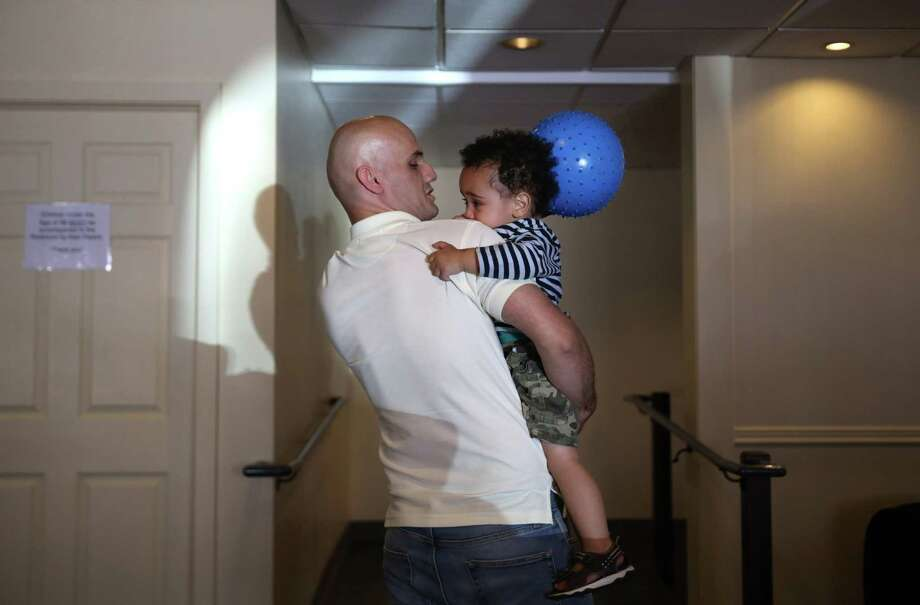 Ebrahim Jafari plays with his son Alraman, 2, in the Mary's Place day center, June 26, 2017. Jafari, who is a refugee from Iran, has 15 years experience as an HVAC specialist, but can't get a job in that industry here without going back to school to get licensed. He and his wife, Medina, and their two sons live at the Mary's Place shelter while he looks for work. Photo: GENNA MARTIN,  SEATTLEPI.COM / SEATTLEPI.COM
