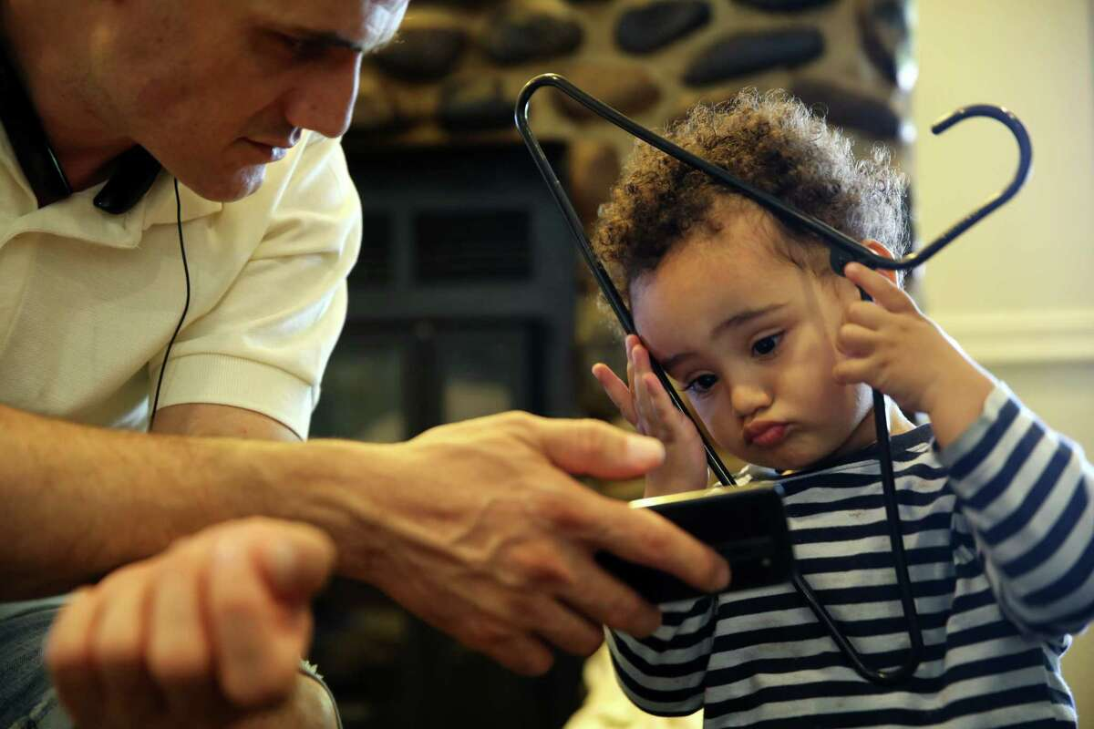 Ebrahim Jafari plays with his son Alraman, 2, in the Mary's Place day center, June 26, 2017.