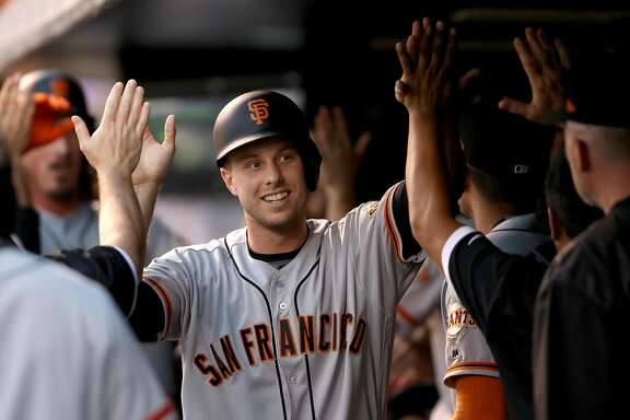 DENVER, CO - JUNE 16:  Austin Slater #53 of the San Francisco Giants is congratulated in the dugout after scoring on a Jeff Samardzija 2 RBI home run in the fifth inning against the Colorado Rockies at Coors Field on June 16, 2017 in Denver, Colorado.  (Photo by Matthew Stockman/Getty Images)