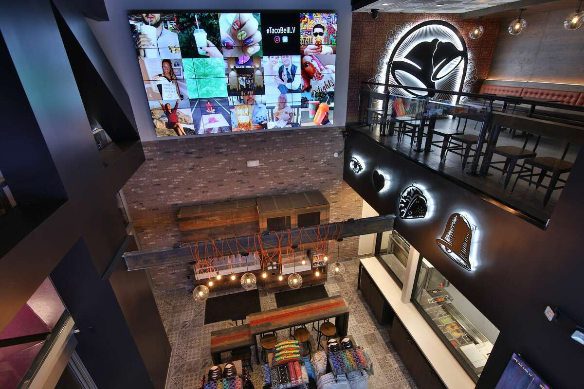 The 24-hour restaurant/store features Taco Bell merchandise and DJ booth.