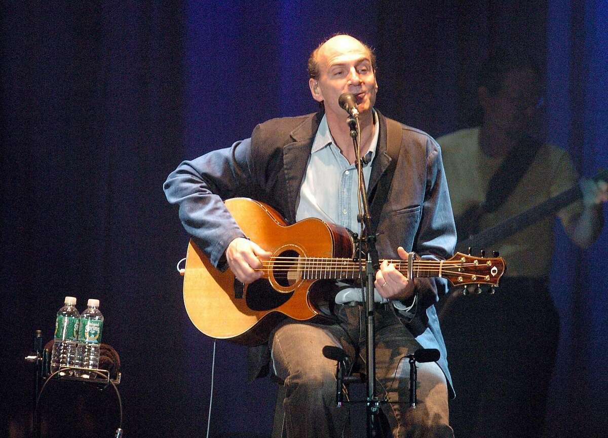 FILE PHOTO 12-19-05 JAMES TAYLOR CONCERT James Taylor performs Monday night at the Arena at Harbor Yard.