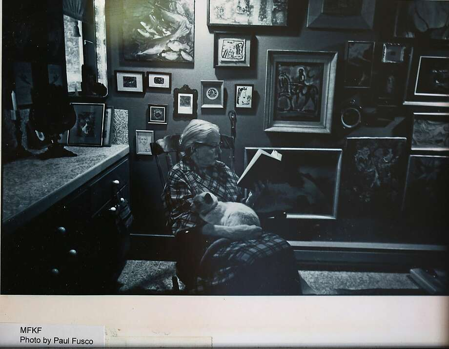 An undated photograph of M.F.K. Fisher reading with her cat in the spacious bathroom of her Glen Ellen home. Photo: Liz Hafalia, The Chronicle