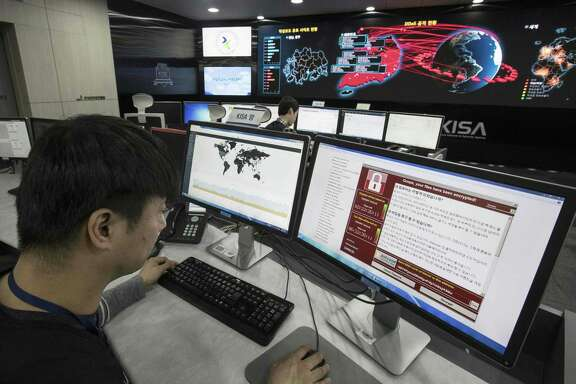 Staff monitors the spread of ransomware cyberattacks at the Korea Internet and Security Agency in Seoul in the aftermath of major cyberattacks in May. On Tuesday, hackers caused widespread disruption across Europe and in the U.S.