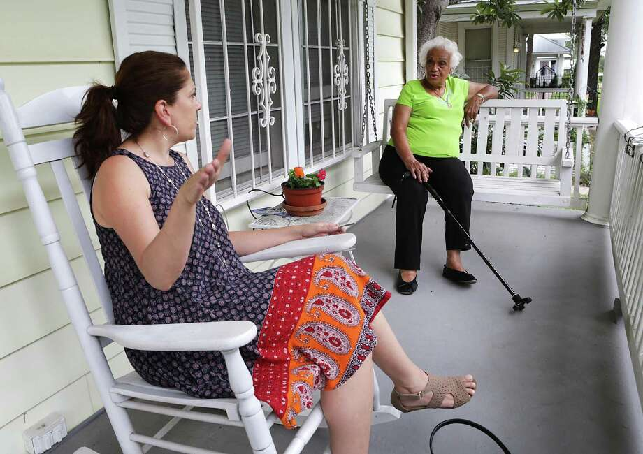 Betty Green (right) a longtime resident of Dignowity Hill on North Pine, speaks with neighbor Anita Lubke who moved to the area just over a year ago, as they sit on her front porch June 14. Photo: Bob Owen /San Antonio Express-News / ©2017 San Antonio Express-News
