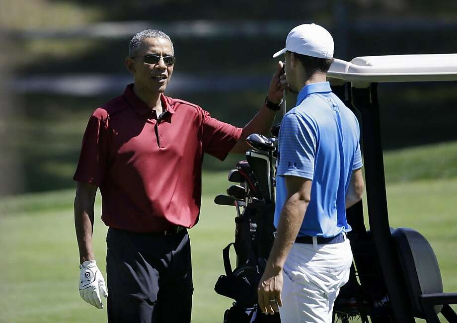 President Barack Obama speaks with NBA basketball player Stephen Curry, of the Golden State Warriors, while golfing, Friday, Aug. 14, 2015, at Farm Neck Golf Club, in Oak Bluffs, Mass., on the island of Martha's Vineyard.  Photo: Steven Senne, Associated Press