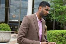 Tim Duncan leaves the federal courthouse in San Antonio Tuesday, June 27, 2017 after giving a victim impact statement during the sentencing phase of the NBA legend's former financial adviser Charles Banks, who admitted he bamboozled Duncan into guaranteeing a $6 million loan used as part of an investment in a sports-merchandise company linked to Banks.