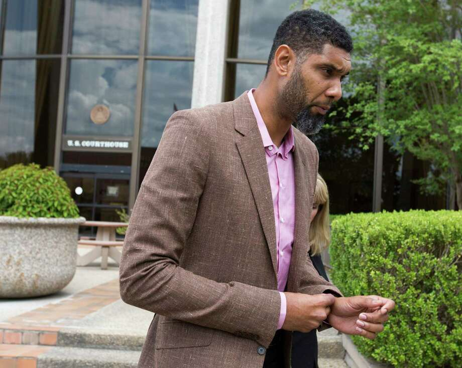 Tim Duncan leaves the federal courthouse in San Antonio Tuesday, June 27, 2017 after giving a victim impact statement during the sentencing phase of the NBA legend's former financial adviser Charles Banks, who admitted he bamboozled Duncan into guaranteeing a $6 million loan used as part of an investment in a sports-merchandise company linked to Banks. Photo: William Luther, San Antonio Express-News / © 2017 San Antonio Express-News