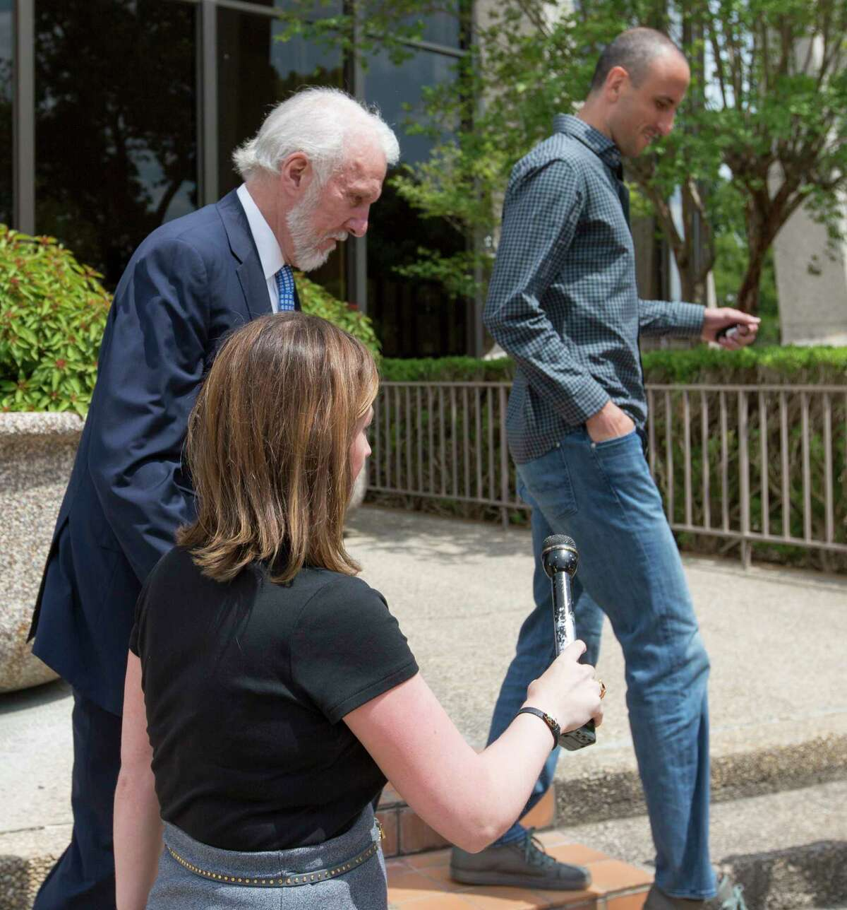 Spurs coach Gregg Popovich, left, and player Manu Ginobili skirt around reporters as they leave the federal courthouse in San Antonio Tuesday, June 27, 2017 after attending a sentencing hearing in Tim Duncan's legal case against Duncan's former financial adviser Charles Banks.