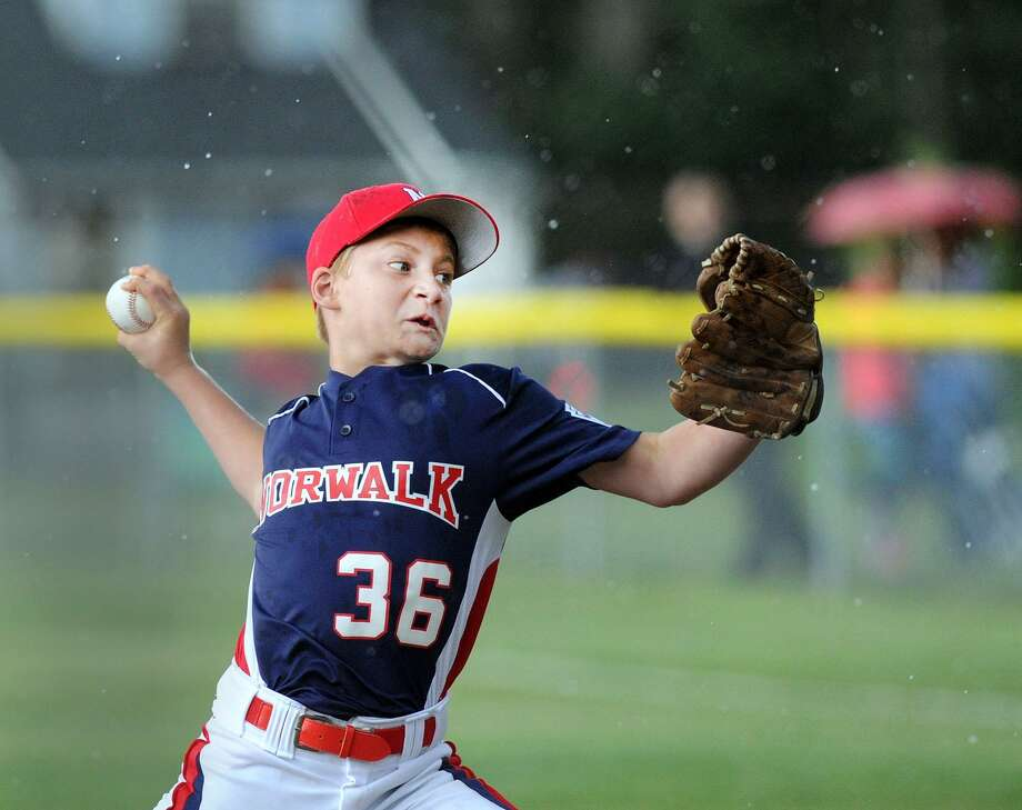 Norwalk pitcher Deron Koppel throws as hailstones fall around him during the Second Distrcit 1 LL baseball game between Stamford American and the Norwalk 12s Little League All-Stars at Broad River Field in Norwalk, Conn., Tuesday, June 27, 2017. The game was called in the 2nd inning due to a thunder and lightning storm with the Norwalk 12s Little League All-Stars in front 1-0. Photo: Bob Luckey Jr. / Hearst Connecticut Media / Greenwich Time