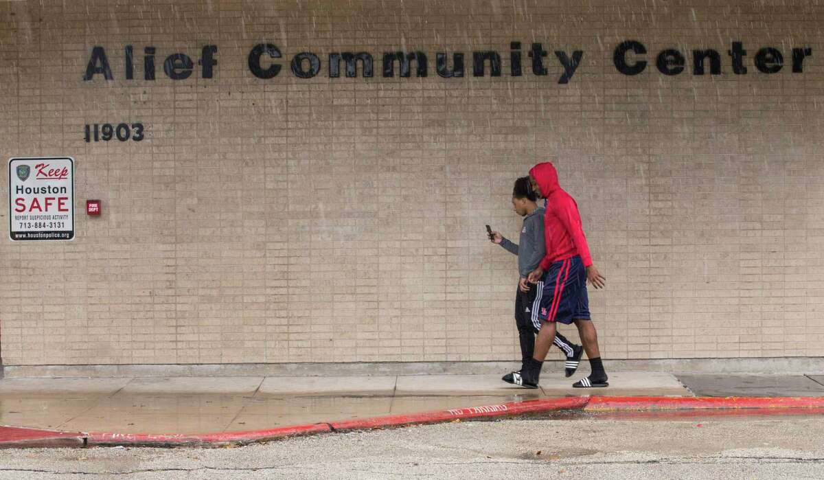 Patrons of the Alief Community Center walk outside the main building on Tuesday, June 27, 2017, in Houston.