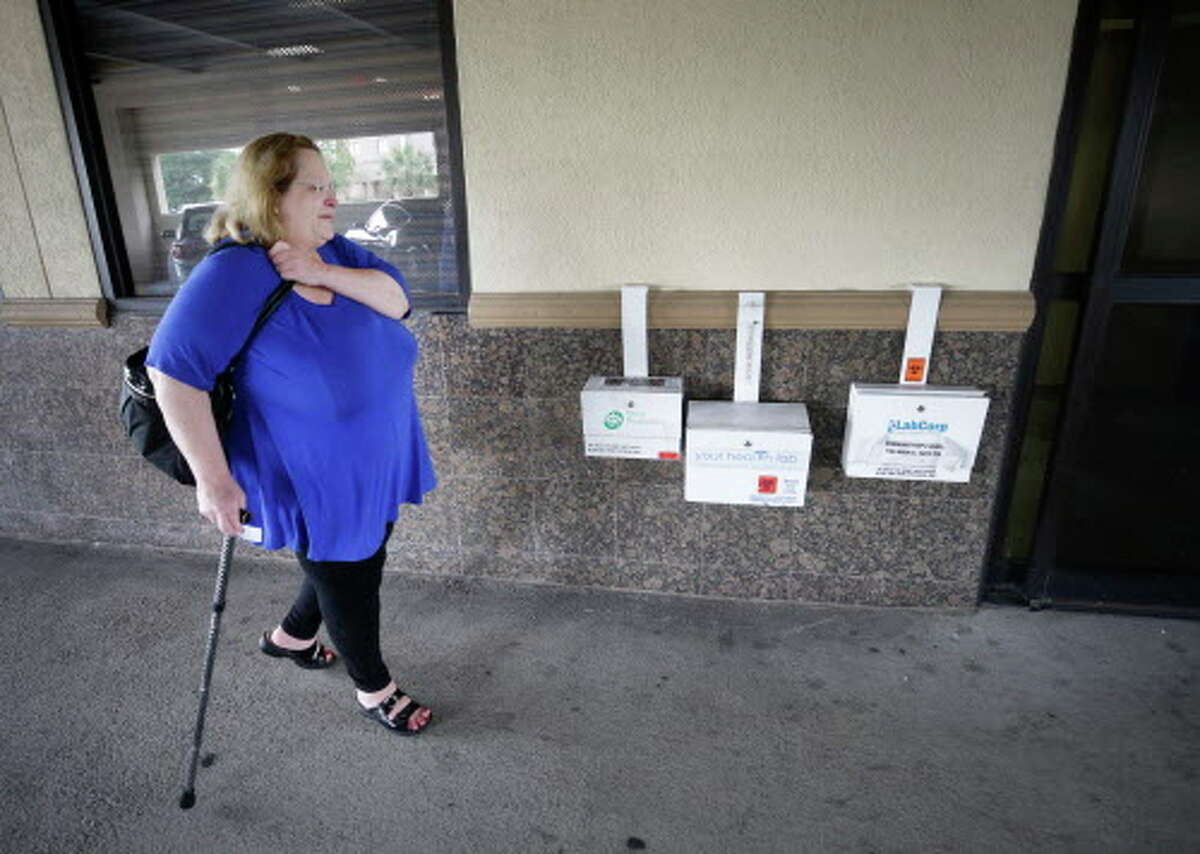 Cherlyn Glanville, a retired Houston ISD French teacher, leaves from a doctor's office Tuesday, June 27, 2017, in Houston. She worries whether she'll be able to afford her medications and doctor visits.