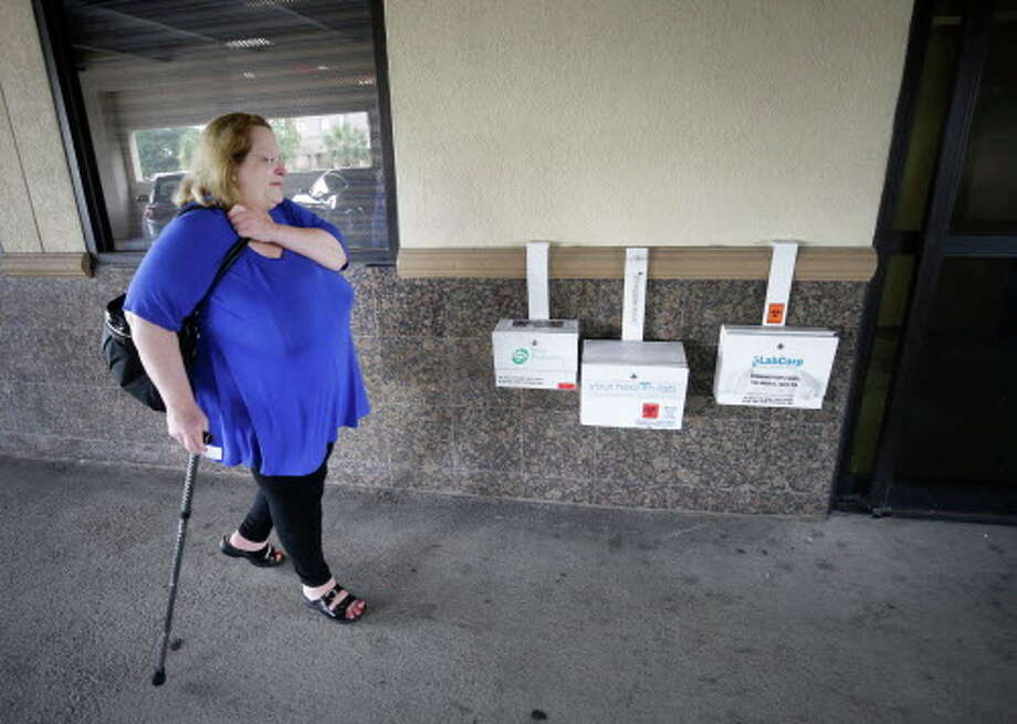 Cherlyn Glanville, a retired Houston ISD French teacher, leaves from a doctor's office Tuesday, June 27, 2017, in Houston. She worries whether she'll be able to afford her medications and doctor visits. Photo: Melissa Phillip, Houston Chronicle / © 2017 Houston Chronicle