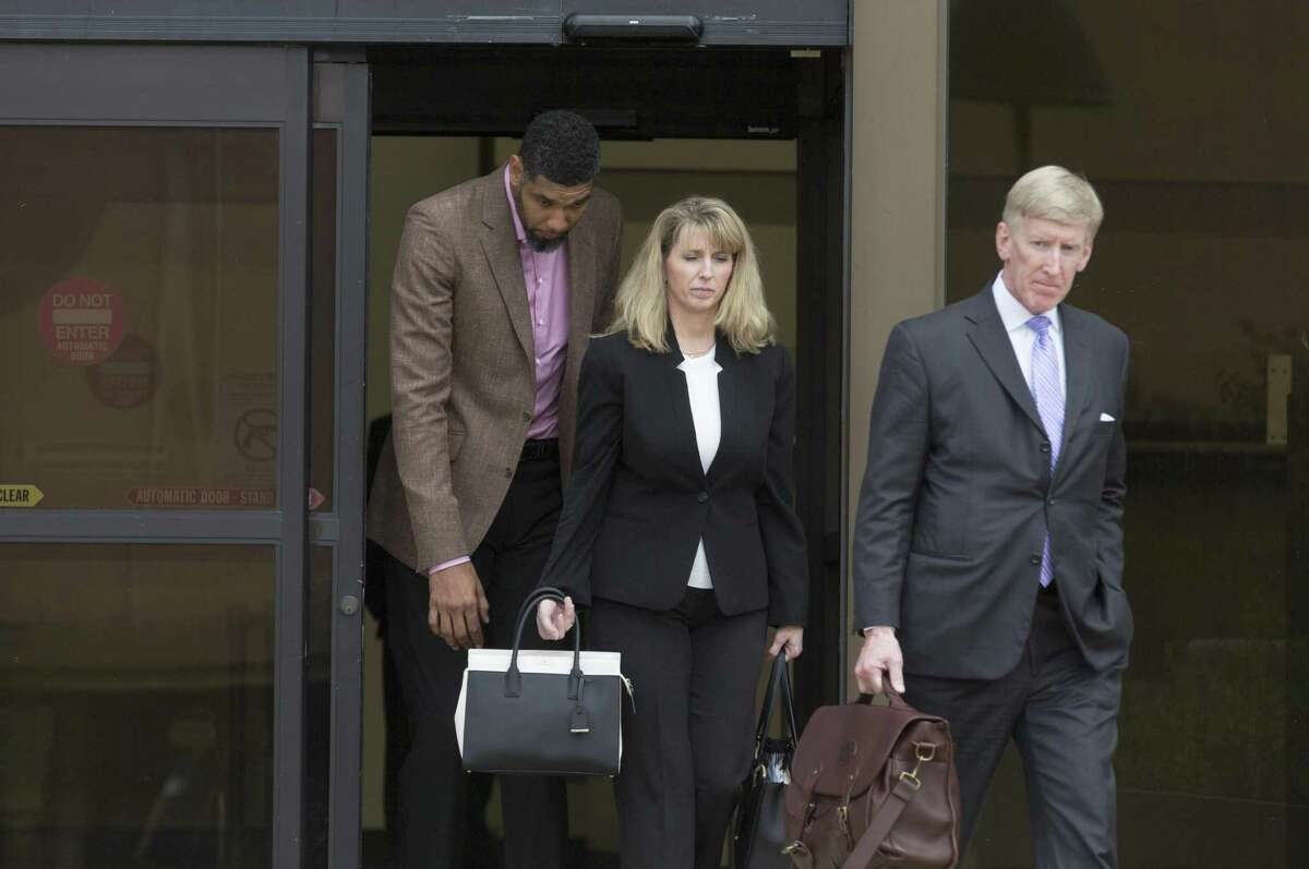 Tim Duncan, left, leaves the federal courthouse in San Antonio Tuesday, June 27, 2017 with his current financial adviser Wendy Kowalik, center, and his attorney Tullos Wells after giving a victim impact statement during the sentencing phase of the NBA legend's former financial adviser Charles Banks, who admitted he bamboozled Duncan into guaranteeing a $6 million loan used as part of an investment in a sports-merchandise company linked to Banks.