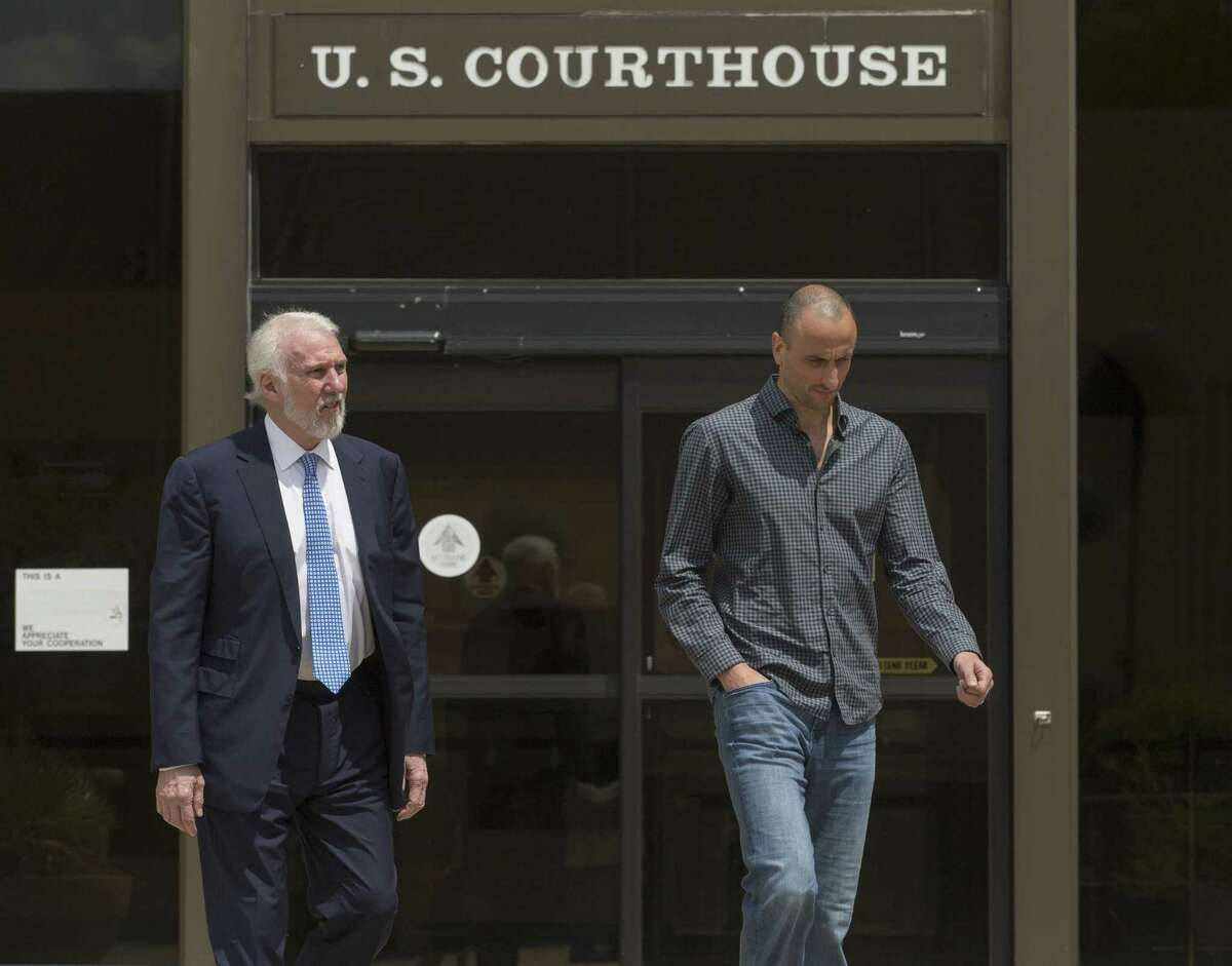 Spurs coach Gregg Popovich, and player Manu Ginobili leave the federal courthouse in after attending a sentencing hearing in Tim Duncan's legal case against former financial adviser Charles Banks.