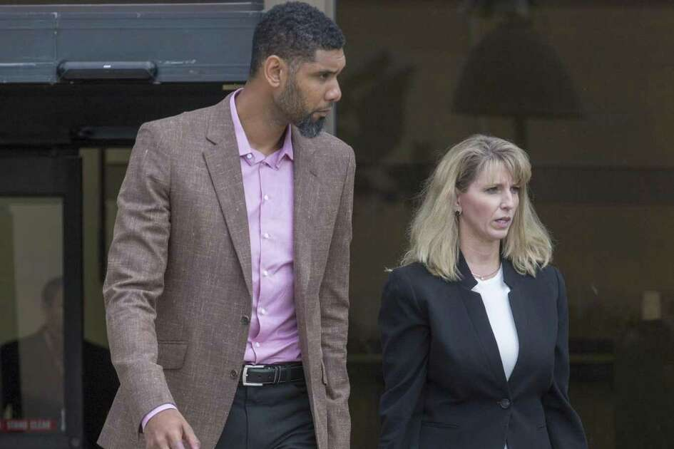 Tim Duncan, left, leaves the federal courthouse in San Antonio Tuesday, June 27, 2017 with Wendy Kowalik, his current financial adviser, after giving a victim impact statement during the sentencing phase of the NBA legend's former financial adviser Charles Banks, who admitted he bamboozled Duncan into guaranteeing a $6 million loan used as part of an investment in a sports-merchandise company linked to Banks.