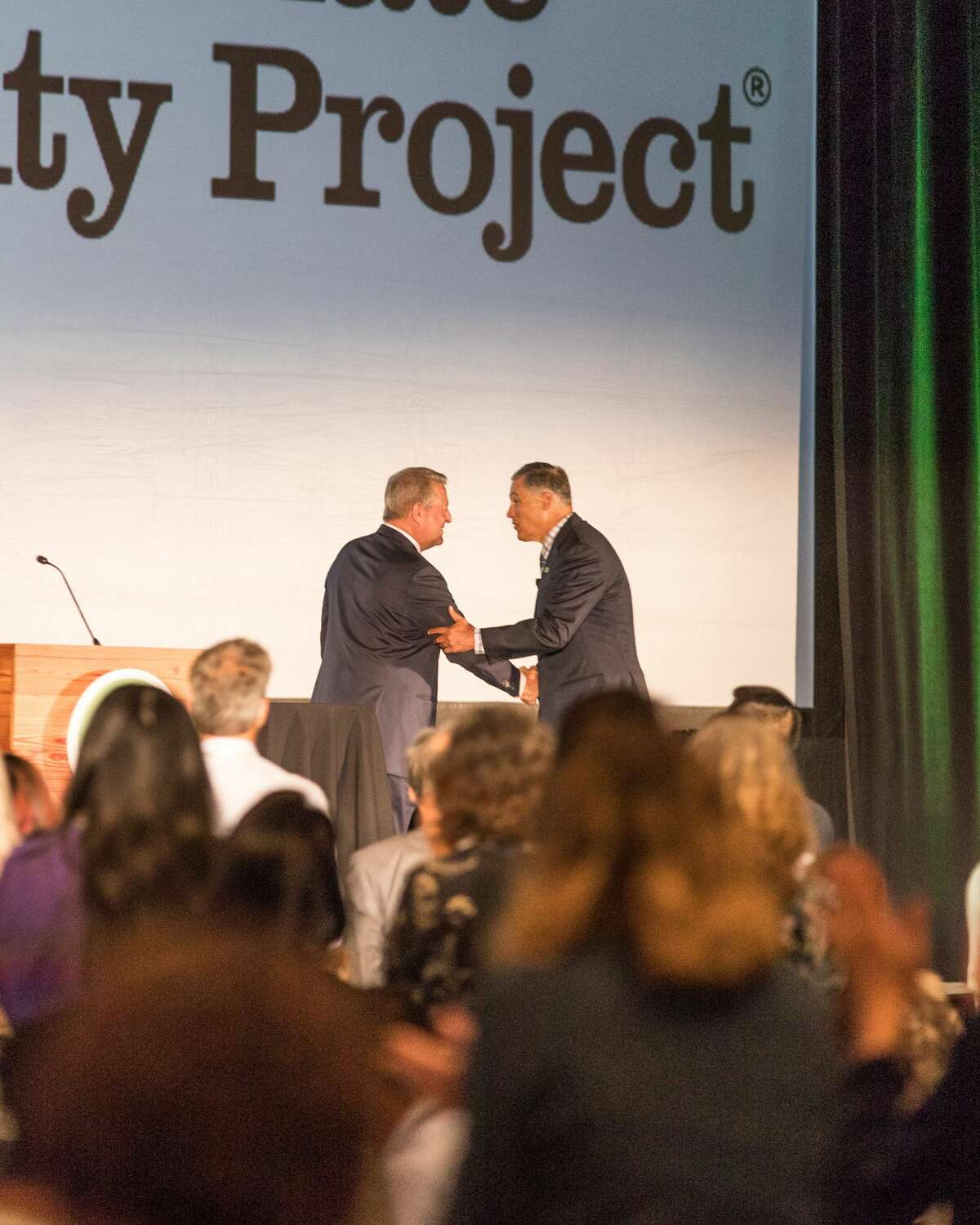 Gov. Jay Inslee and ex-Vice President Al Gore speak at a Climate Reality Project training program at the Meydenbauer Center in Bellevue on June 27, 2017.