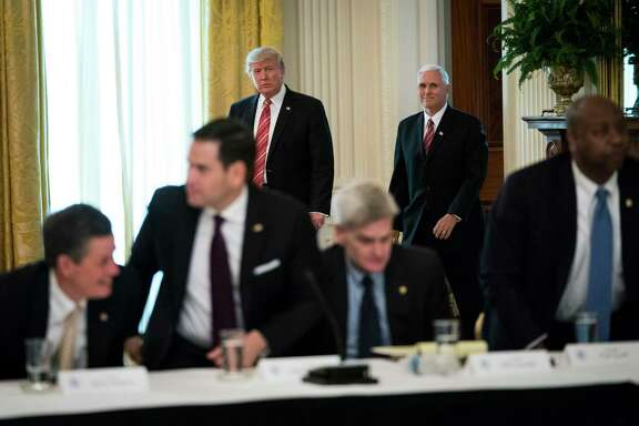 President Donald Trump and Vice President Mike Pence arrive for a meeting with Senate Republicans to discuss health care legislation Tuesday.
