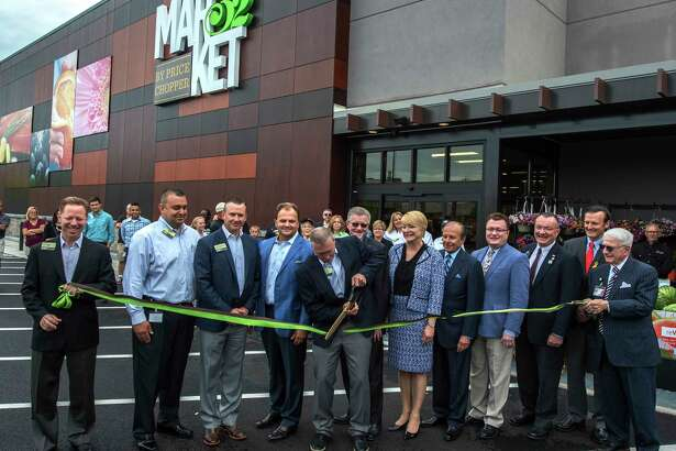 Store manager Edward Gendron cuts the ribbon surrounded by elected and Market 32 officials during the opening ceremony of the new Market 32 Tuesday June 26, 2017 in Clifton Park, N.Y.  (Skip Dickstein/Times Union)
