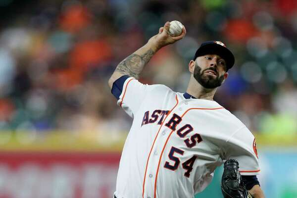 Houston Astros starting pitcher Mike Fiers (54) pitches during the first inning of an MLB baseball game at Minute Maid Park, Tuesday, June, 27, 2017.