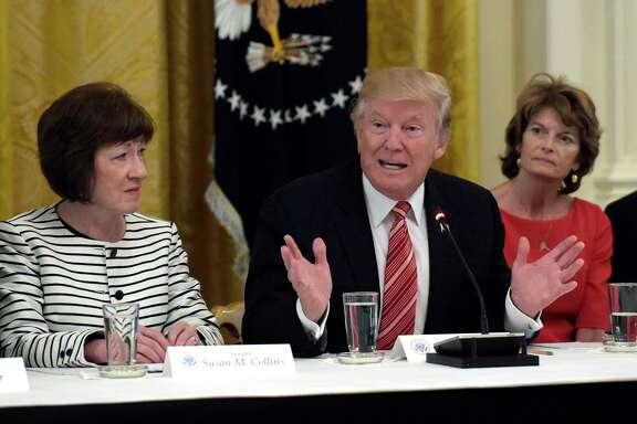 President Donald Trump meets with Republican senators including Sen. Susan Collins of Maine, left, and Sen. Lisa Murkowski of Alaska.