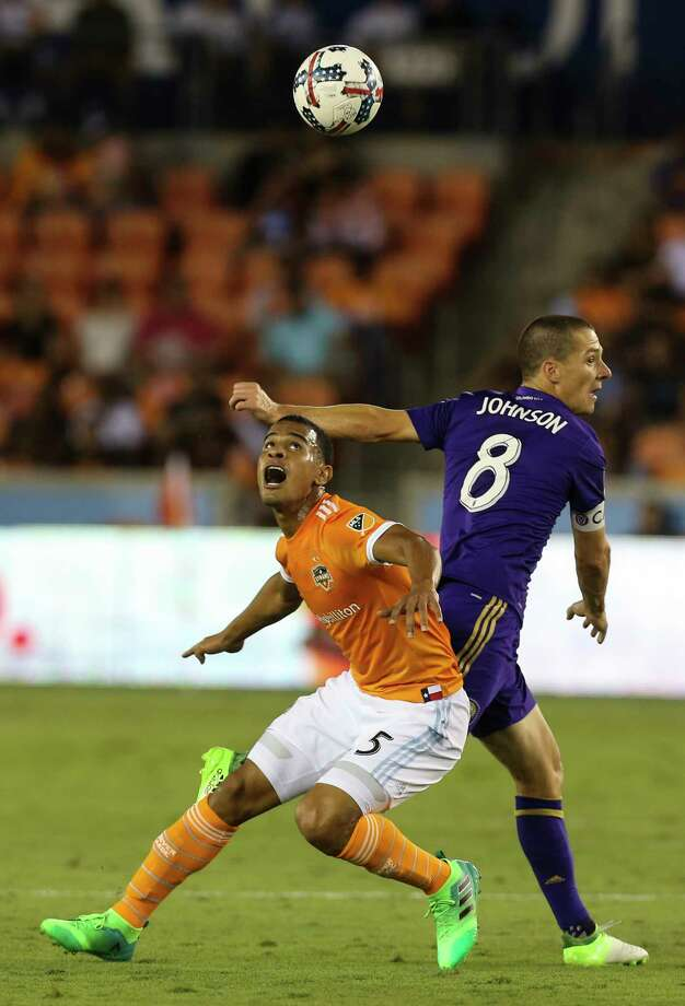 Houston Dynamo midfielder Juan Cabezas (5) and Orlando City SC forward Will Johnson (8) battle for a header during the first half of the game at BBVA Compass Stadium Saturday, May 6, 2017, in Houston. ( Yi-Chin Lee / Houston Chronicle ) Photo: Yi-Chin Lee, Staff / © 2017  Houston Chronicle