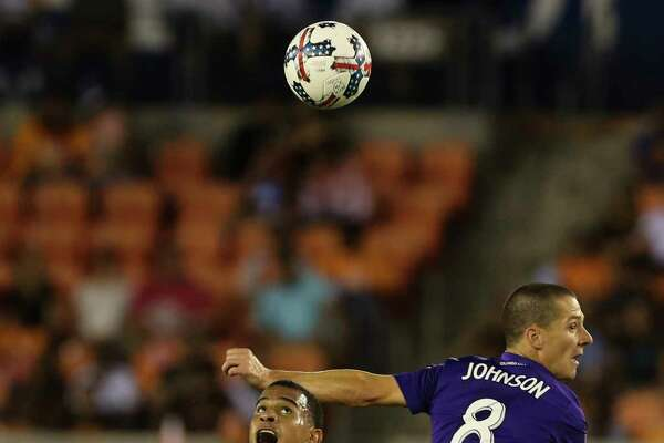 Houston Dynamo midfielder Juan Cabezas (5) and Orlando City SC forward Will Johnson (8) battle for a header during the first half of the game at BBVA Compass Stadium Saturday, May 6, 2017, in Houston. ( Yi-Chin Lee / Houston Chronicle )