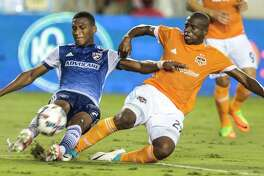 Midfielder Oscar Garcia, right, and the Dynamo are taking a break from MLS competition, but Wednesday's U.S. Open Cup game presents a familiar foe in Sporting Kansas City.