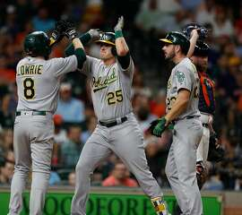 Oakland Athletics Ryon Healy celebrates his grand slam with Jed Lowrie (8) during the sixth inning of an MLB baseball game at Minute Maid Park, Tuesday, June, 27, 2017.  ( Karen Warren / Houston Chronicle )