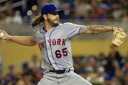 MIAMI, FL - JUNE 27:  Robert Gsellman #65 of the New York Mets pitches during a game against the Miami Marlins at Marlins Park on June 27, 2017 in Miami, Florida.  (Photo by Mike Ehrmann/Getty Images) ORG XMIT: 700011407