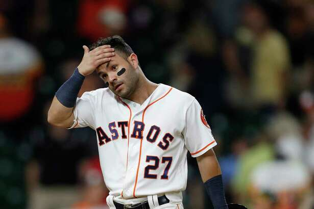 Houston Astros Jose Altuve (27) reacts as he walks back to the dugout after the Astros tried to rally back during the ninth inning of an MLB baseball game at Minute Maid Park, Tuesday, June, 27, 2017.