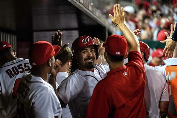 Nationals third baseman Anthony Rendon, center, is congratulated in the dugout after scoring a on a two-run double by teammate Michael A. Taylor in the fifth inning of Tuesday's game against the Cubs in Washington, D.C. Must credit: Washington Post photo by Toni L. Sandys
