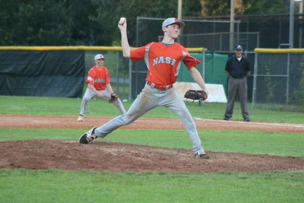 Henry Hill delivers to the plate during his work in the fifth inning. The NASA-Orange pitching weaved a two-hitter in guiding the team to the Directors Tournament crown Tuesday night.