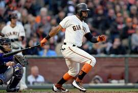 SAN FRANCISCO, CA - JUNE 27:  Denard Span #2 of the San Francisco Giants hits an rbi single scoring Gorkys Hernandez #66 against the Colorado Rockies in the bottom of the third inning at AT&T Park on June 27, 2017 in San Francisco, California.  (Photo by Thearon W. Henderson/Getty Images)