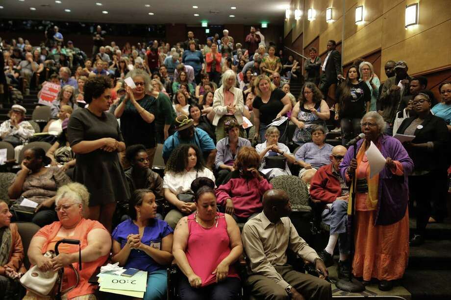 People stand and applaud as Rev. Harriett Walden, co-founder of Mothers for Police Accountability, speaks to hundreds attending a city hall hearing with the Seattle City Council over the killing of Charleena Lyles by Seattle police officers, Tuesday, June 27, 2017 at UW's Kane Hall. Photo: GENNA MARTIN, SEATTLEPI.COM / SEATTLEPI.COM