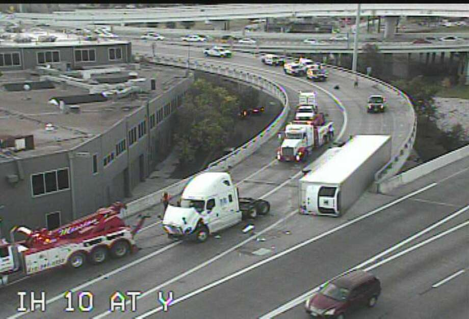 An 18-wheeler has overturned at the Finesilver curve near downtown on May 31, 2017. Photo: TxDOT