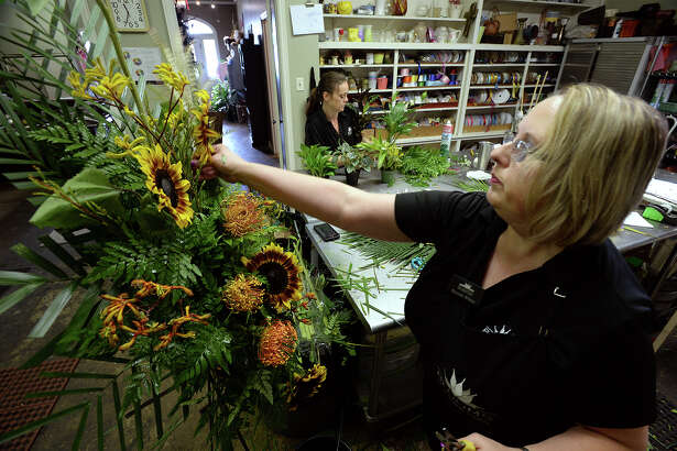 Krista Tanner, left, and Brenda White construct funeral arrangements Tuesday at Blooms in Beaumont.  Stemming from family requests, making donations instead of flowers has become more common for funeral services. Photo taken Tuesday, June 27, 2017 Guiseppe Barranco/The Enterprise