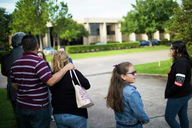 Juan Rodriguez and his wife Celia Rodriguez wait across from the ICE headquarters for the offices to open so Juan can go in and receive instructions about his 60-day reprieve, Monday, June 26, 2017, in Houston. Juan has been checking in with immigration officials for years and was allowed to stay in the country under prosecutorial discretion but still every visit to the building causes his and his family anxiety. Photo: Marie D. De Jesus, Houston Chronicle / © 2017 Houston Chronicle
