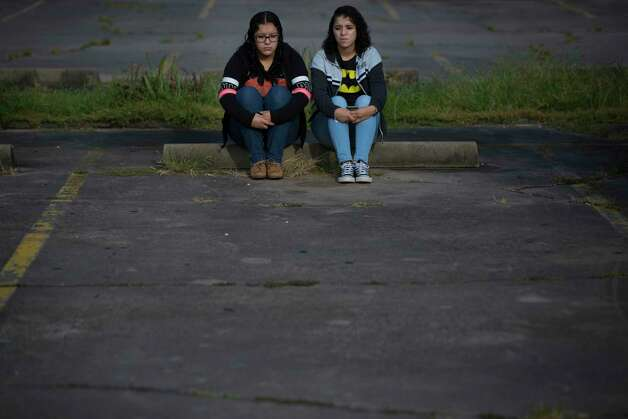 Rebecca Rodriguez, 15, and her older sister Karen Rodriguez, 18, sit at the parking lot of their father's lawyer office across from the ICE headquarters where the family will present themselves so their father Juan Rodriguez can receive information about the 60-day reprieve the U.S government granted him. Every visit to the ICE headquarters in Houston causes them stress. Monday, June 26, 2017, in Houston. Photo: Marie D. De Jesus, Houston Chronicle / © 2017 Houston Chronicle