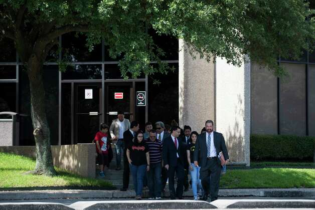 Juan Rodriguez and his family walk out of U.S. Citizenship and Immigration Services building on 126 Northpoint Drive, Monday, June 26, 2017, in Houston where Rodriguez had to meet with ICE officials for instruction on the conditions of the 60 days extension. The Rodriguez family was accompanied by their team of lawyers and supporters. Photo: Marie D. De Jesus, Houston Chronicle / © 2017 Houston Chronicle