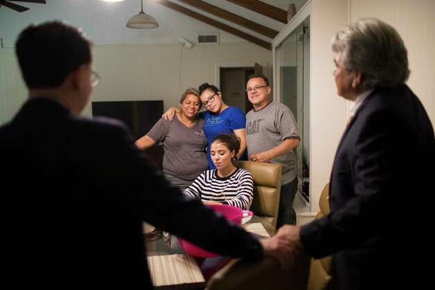 The Rodriguez family, Celia Rodriguez, Rebecca Rodriguez, 15, Karen Rodriguez, 18, and Juan Rodriguez, listen to their attorneys Juan Velazquez, left, and Juan Medina, right, while they share watermelons celebrating the 60-day reprieve granted by the U.S. government, Friday, June 23, 2017, in Houston. Photo: Marie D. De Jesus, Houston Chronicle / © 2017 Houston Chronicle