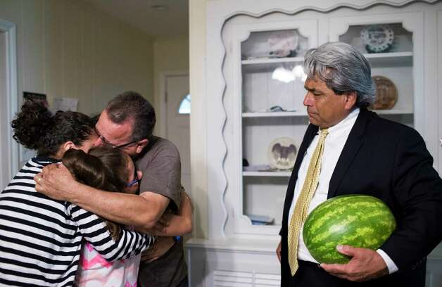 Juan Rodriguez embraces his daughters Karen Rodriguez, 18, Kimberly Rodriguez, 10, and Rebecca Rodriguez as he is received by his family and one of the family's attorneys David Medina, right, Friday, June 23, 2017, in Houston. Photo: Marie D. De Jesus, Houston Chronicle / © 2017 Houston Chronicle