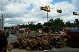 Lumber is in the road at Business 96 and FM 327 in Silsbee after a logging truck overturned Wednesday, June 28, 2017.