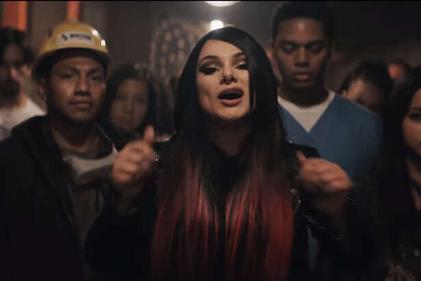 "Snow Tha Product in the video for ""Immigrants (We Get the Job Done)"" from ""The Hamilton Mixtape."""