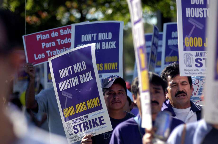 Hundreds of Houston area janitors and supporters marched down San Felipe St. during a Service Employees International Union (SEIU) march and rally that began at Grady Park in the Galleria, Saturday, Oct. 28, 2006. About 4,700 low-wage janitors in Houston have formed a union with SEIU and an additional 600 janitors will soon join in their fight for fair wages and benefits. (Johnny Hanson for the Houston Chronicle) Photo: Johnny Hanson, Freelance / Freelance