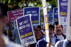 Hundreds of Houston area janitors and supporters marched down San Felipe St. during a Service Employees International Union (SEIU) march and rally that began at Grady Park in the Galleria, Saturday, Oct. 28, 2006. About 4,700 low-wage janitors in Houston have formed a union with SEIU and an additional 600 janitors will soon join in their fight for fair wages and benefits. (Johnny Hanson for the Houston Chronicle)