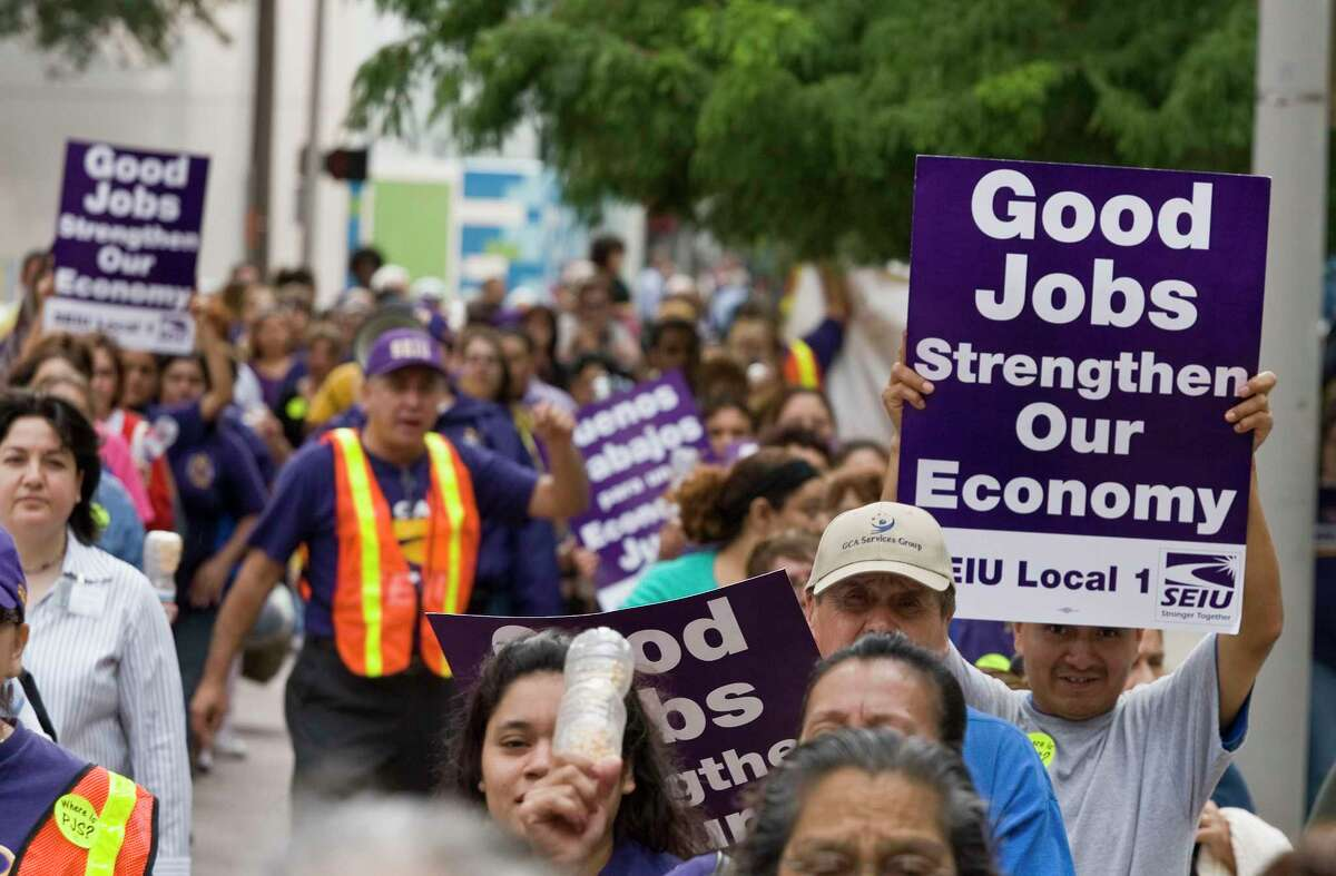 Members and backers of the Service Employees International Union march along Louisiana Street during a 2009 rally.