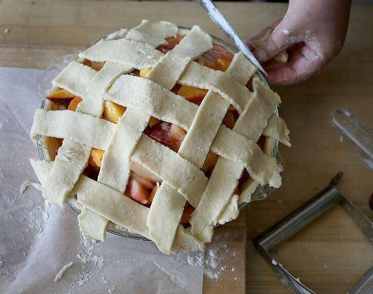 """Elizabeth Simon of Revenge Pies makes peach pie as she shows how to make """"picecream"""" (a hybrid mash-up of pie meets ice cream) on Monday, June 12, 2017, in San Francisco, Calif."""