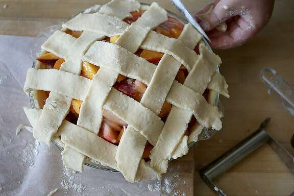 "Elizabeth Simon of Revenge Pies makes peach pie as she shows how to make ""picecream"" (a hybrid mash-up of pie meets ice cream) on Monday, June 12, 2017, in San Francisco, Calif."
