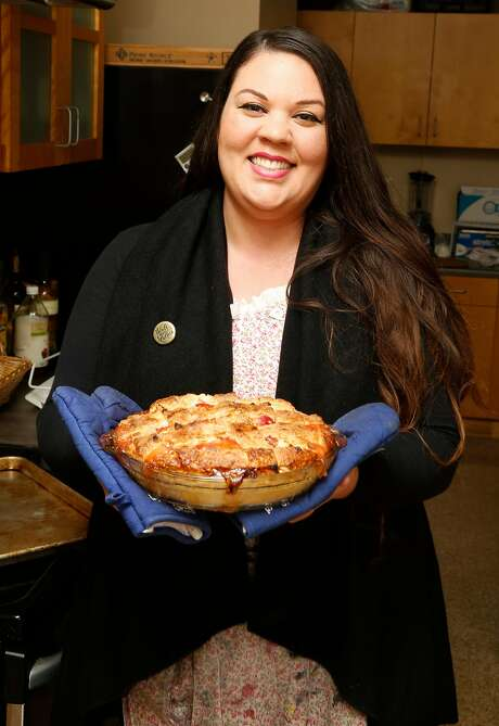 Elizabeth Simon of Revenge Pies in S.F. with her homemade peach pie. Photo: Liz Hafalia, The Chronicle